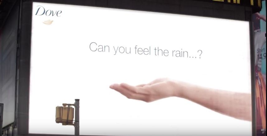 Dove experiments with weather sensitive billboard in 'April Showers' campaign